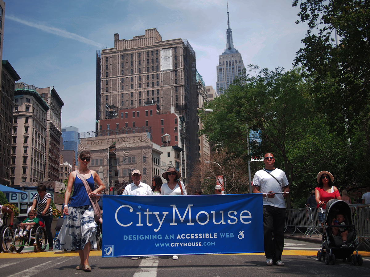 A photo of the CityMouse team walking in the disability pride parade.