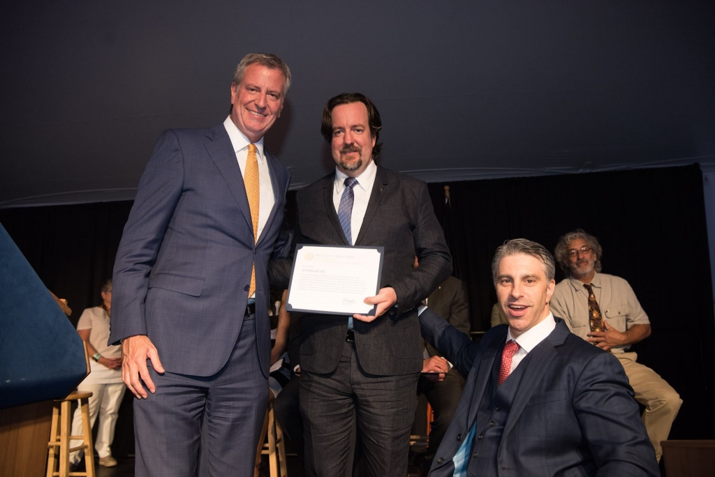 Photo of John Kirkwood with Mayor Bill De Blasio and Commissioner Victor Calise.